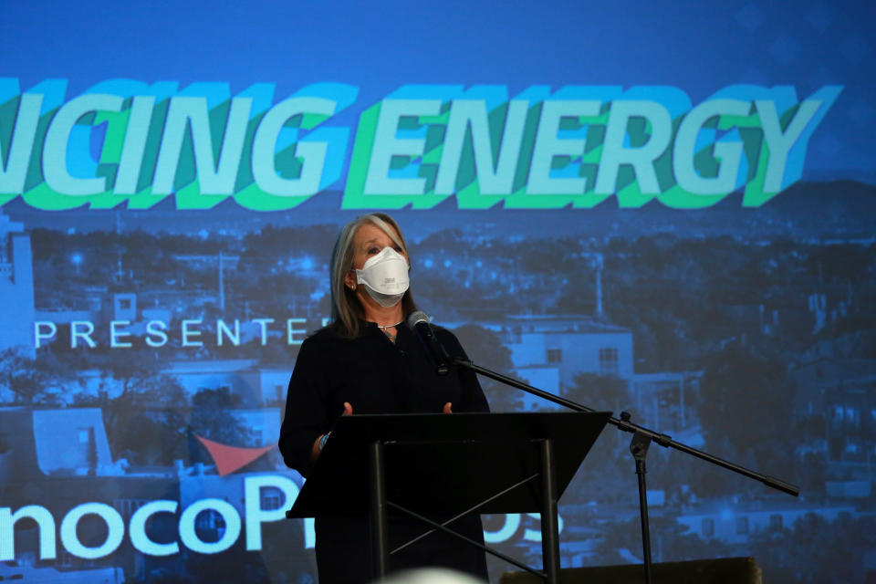 Democratic Gov. Michelle Lujan Grisham addresses energy executives at the New Mexico Oil And Gas Association meeting on Monday, Oct. 4, 2021, in Santa Fe, New Mexico. Lujan Grisham has moved to crack down on pollution from gas extraction while also trying to shield the state's producers from a drilling moratorium by the Biden administration. New Mexico relies on oil and gas royalties for around one third of its budget. (AP Photo/Cedar Attanasio)