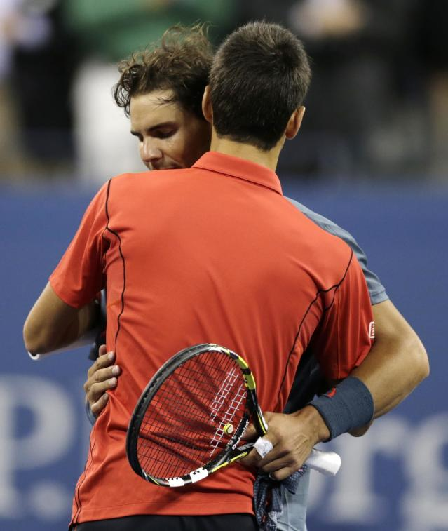 Rafael Nadal, of Spain, left, greets Novak Djokovic, of Serbia, at the net after winning the men's singles final of the 2013 U.S. Open tennis tournament, Monday, Sept. 9, 2013, in New York. (AP Photo/Charles Krupa)