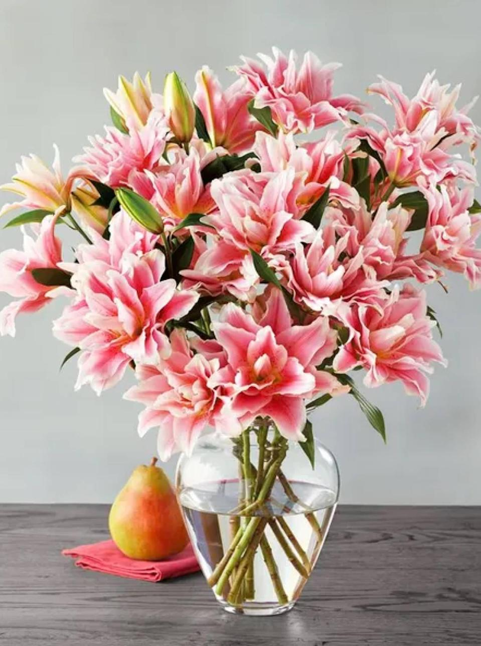 """Look to Harry & David for a virtually endless supply of fresh bouquets, potted plants, and edible arrangements (a top-notch <a href=""""https://www.glamour.com/gallery/gifts-for-foodies?mbid=synd_yahoo_rss"""" rel=""""nofollow noopener"""" target=""""_blank"""" data-ylk=""""slk:foodie gift"""" class=""""link rapid-noclick-resp"""">foodie gift</a>, FYI). The website's selection *can* be overwhelming, so narrow down options by occasion and budget. Heads up: Harry & David doesn't ship to P.O. boxes, and you'll want to check its <a href=""""https://cna.st/affiliate-link/r6wFKS8kAbvwZPpxz5efPvRrbR5SNqAHbkM7j3ZVTjFPFG8Uv1S5Znmh7UzkCfH1sjf74pAZToFMf2LeNcovGr2HvpEuoQ1Y6ragfWBKkXYFNYnZk?cid=608196a59b19107e88e7c951"""" rel=""""nofollow noopener"""" target=""""_blank"""" data-ylk=""""slk:cut-off dates"""" class=""""link rapid-noclick-resp"""">cut-off dates</a> for holiday-specific orders. $80, Roselily Bouquet. <a href=""""https://www.harryanddavid.com/h/flowers-plants/flower-arrangements-bouquets/31421"""" rel=""""nofollow noopener"""" target=""""_blank"""" data-ylk=""""slk:Get it now!"""" class=""""link rapid-noclick-resp"""">Get it now!</a>"""