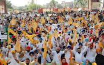 AMRITSAR, INDIA SEPTEMBER 25: Shiromani Akali Dal (SAD) leaders and workers raise slogans and block the road at Golden Gate during Punjab bandh, a statewide farmers' strike against the recent passing of agriculture reform bills in the Parliament, on September 25, 2020 in Amritsar, India. The two bills - the Farmers (Empowerment and Protection) Agreement on Price Assurance and Farm Services Bill, 2020 and the Farming Produce Trade and Commerce (Promotion and Facilitation) Bill, 2020 - were passed by the Rajya Sabha despite uproar and strong protest by the Opposition parties in the house. (Photo by Sameer Sehgal/Hindustan Times via Getty Images)