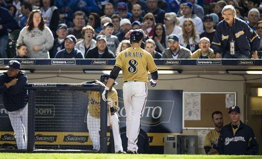 CORRECTS LEAGUE - Milwaukee Brewers' Ryan Braun walks to the dugout after being ejected by home plate umpire Phil Cuzzi during the eighth inning of an MLB National League baseball game against the Chicago Cubs Sunday, April 21, 2013, in Milwaukee. (AP Photo/Tom Lynn)