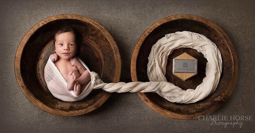 A photo of newborn baby, Tiger, lying next to the ashes of his late brotherJohnny – with the pair connected by a symbolic umbilical cord of white muslin cloth – won big at an international photography show. Photo: Sarah Simmons