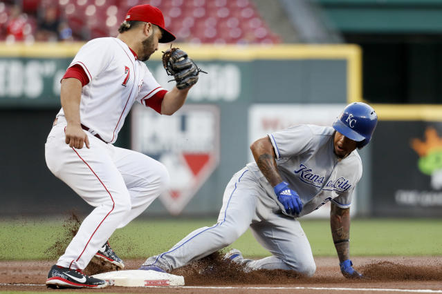 Kansas City Royals' Adalberto Mondesi, right, steals third against Cincinnati Reds third baseman Eugenio Suarez (7) during the first inning of a baseball game Wednesday, Sept. 26, 2018, in Cincinnati. (AP Photo/John Minchillo)