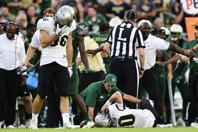 UCF's Michael Colubiale (86) reacts to McKenzie Milton's injury against South Florida in November. (Getty)
