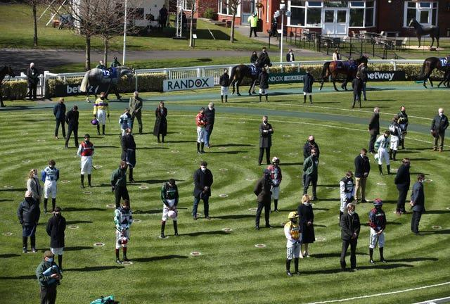Racegoers and riders at Aintree observe a two-minute silence for the late Prince Philip, Duke of Edinburgh