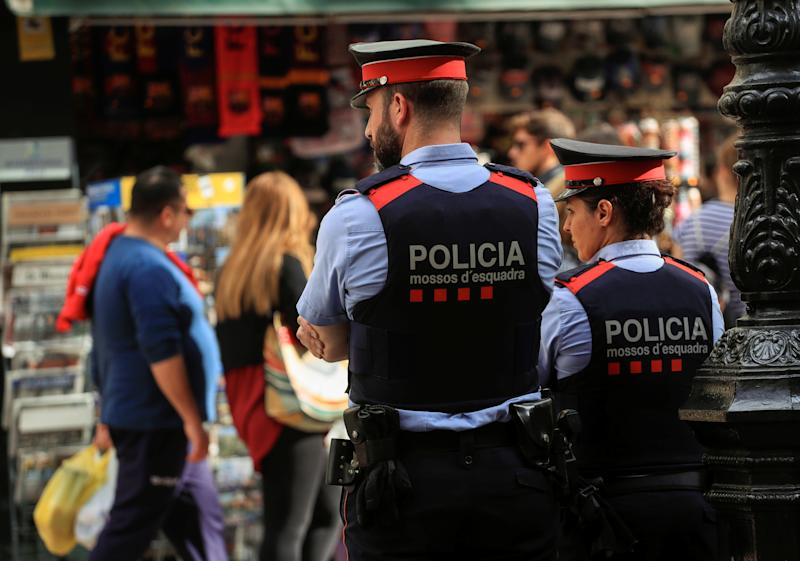 Mossos d'Esquadra, Catalan regional police officers, patrol along La Rambla street the day after the Catalan regional parliament declared independence from Spain in Barcelona, Spain, October 28, 2017. REUTERS/Juan Medina