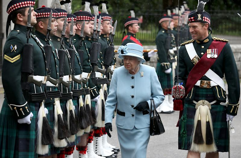 Queen Elizabeth II inspects the Balaklava Company, 5 Battalion The Royal Regiment of Scotland at the gates at Balmoral, as she takes up summer residence at the castle. (Photo by Andrew Milligan/PA Images via Getty Images)