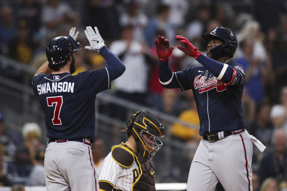 Atlanta Braves' Jorge Soler, right, is congratulated by Dansby Swanson (7) after hitting a three-run home run against the San Diego Padres in the sixth inning of a baseball game Saturday, Sept. 25, 2021, in San Diego. (AP Photo/Derrick Tuskan)