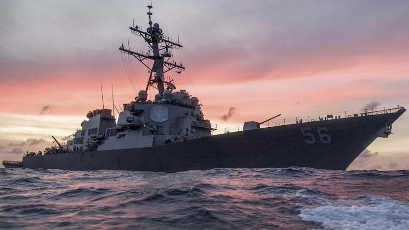 The U.S. Navy destroyer USS John S. McCain conducts a patrol in the South China Sea