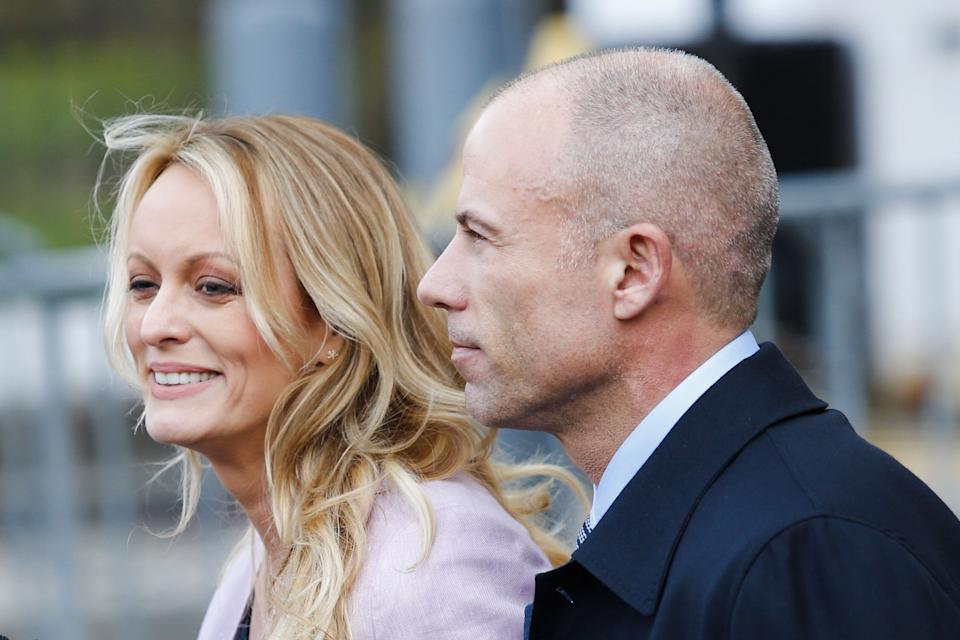 Adult-film actress Stephanie Clifford, also known as Stormy Daniels and her lawyer Michael Avenatti exit the US Federal Court on April 16, 2018, in Lower Manhattan, New York. President Donald Trump's personal lawyer Michael Cohen has been under criminal investigation for months over his business dealings, and FBI agents last week raided his home, hotel room, office, a safety deposit box and seized two cellphones. Some of the documents reportedly relate to payments to porn star Stormy Daniels, who claims a one-night stand with Trump a decade ago, and ex Playboy model Karen McDougal who also claims an affair. / AFP PHOTO / EDUARDO MUNOZ ALVAREZ        (Photo credit should read EDUARDO MUNOZ ALVAREZ/AFP via Getty Images)