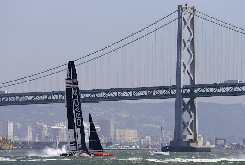 Oracle Team USA returns to base Tuesday, Sept. 17, 2013, in San Francisco. The 11th and 12th races of the America's Cup sailing event were postponed due to strong winds. (AP Photo/Ben Margot)