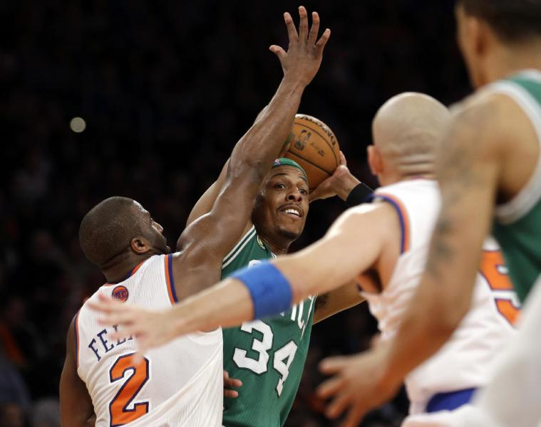Boston Celtics forward Paul Pierce (34) looks to pass as New York Knicks guard Raymond Felton (2) defends in the second half of Game 1 of the NBA basketball playoffs in New York, Saturday, April 20, 2013. The Knicks defeated the Celtics 85-78. (AP Photo/Kathy Willens)