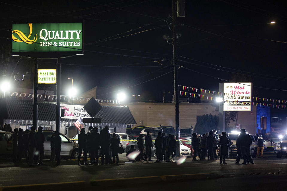 Protesters faced off with law enforcement officers at NE Highway 99, in Vancouver, Wash., Thursday, Oct. 29, 2020, after a police shooting. Authorities say sheriff's deputies in Clark County, Washington, were involved in a shooting, but didn't release details. A man told The Oregonian/OregonLive his 21-year-old son was killed by police. (Mark Graves/The Oregonian via AP)