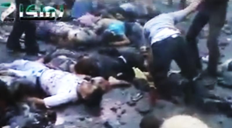 EDS NOTE: GRAPHIC CONTENT - This image made from amateur video released by the Syrian Observatory for Human Rights and accessed Saturday, June 30, 2012, purports to show a Syrian helping a man near dead bodies on the ground after an explosion in Zamalka near Damascus, Syria. In the latest episode, activists said dozens of people were killed and wounded in a powerful explosion Saturday evening that hit a funeral procession in a suburb of the Syrian capital Damascus. Details of the blast in Zamalka remain murky, but amateur videos showed gruesome images of bodies, some with their limbs torn, lying on the ground as people walked about dazed in a cloud of smoke. (AP Photo/Syrian Observatory for Human Rights via AP video) TV OUT, THE ASSOCIATED PRESS CANNOT INDEPENDENTLY VERIFY THE CONTENT, DATE, LOCATION OR AUTHENTICITY OF THIS MATERIAL