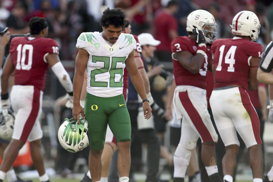 Oregons' Travis Dye (26) walks off the field after losing to Stanford after overtime in an NCAA college football game in Stanford, Calif., Saturday, Oct. 2, 2021. (AP Photo/Jed Jacobsohn)