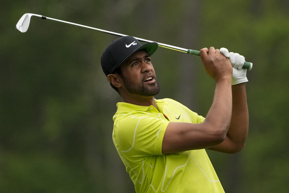 Tony Finau watches his tee shot on the 12th hole during the second round of the Masters golf tournament on Friday, April 9, 2021, in Augusta, Ga. (AP Photo/Charlie Riedel)