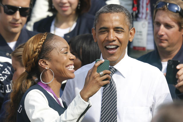 U.S. Olympic 400m sprint gold medalist Sanya Richards-Ross (L) takes a picture with U.S. President Barack Obama as the 2012 U.S. Olympic and Paralympic teams visit the White House in Washington, September 14, 2012. REUTERS/Jonathan Ernst (UNITED STATES - Tags: POLITICS SPORT OLYMPICS TPX IMAGES OF THE DAY)