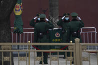 Chinese paramilitary policemen change shifts on the streets of Beijing near the Great Hall of the People on Wednesday, March 3, 2021. In a sign of confidence China has reverted back to holding its annual Congress meetings to march this year after delaying them due to the outbreak of the coronavirus last year. As usual, security has been tightened in the capital with paramilitary troops patrolling near the Great Hall of the People where the meetings are held and standing guard at subway stations. (AP Photo/Ng Han Guan)