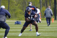 Chicago Bears running back Khalil Herbert (24) runs during the NFL football team's rookie minicamp Friday, May, 14, 2021, in Lake Forest Ill. (AP Photo/David Banks, Pool)