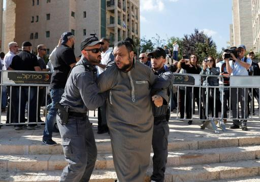 Israeli police detain a demonstrator outside the opening of the US embassy in Jerusalem on May 14, 2018