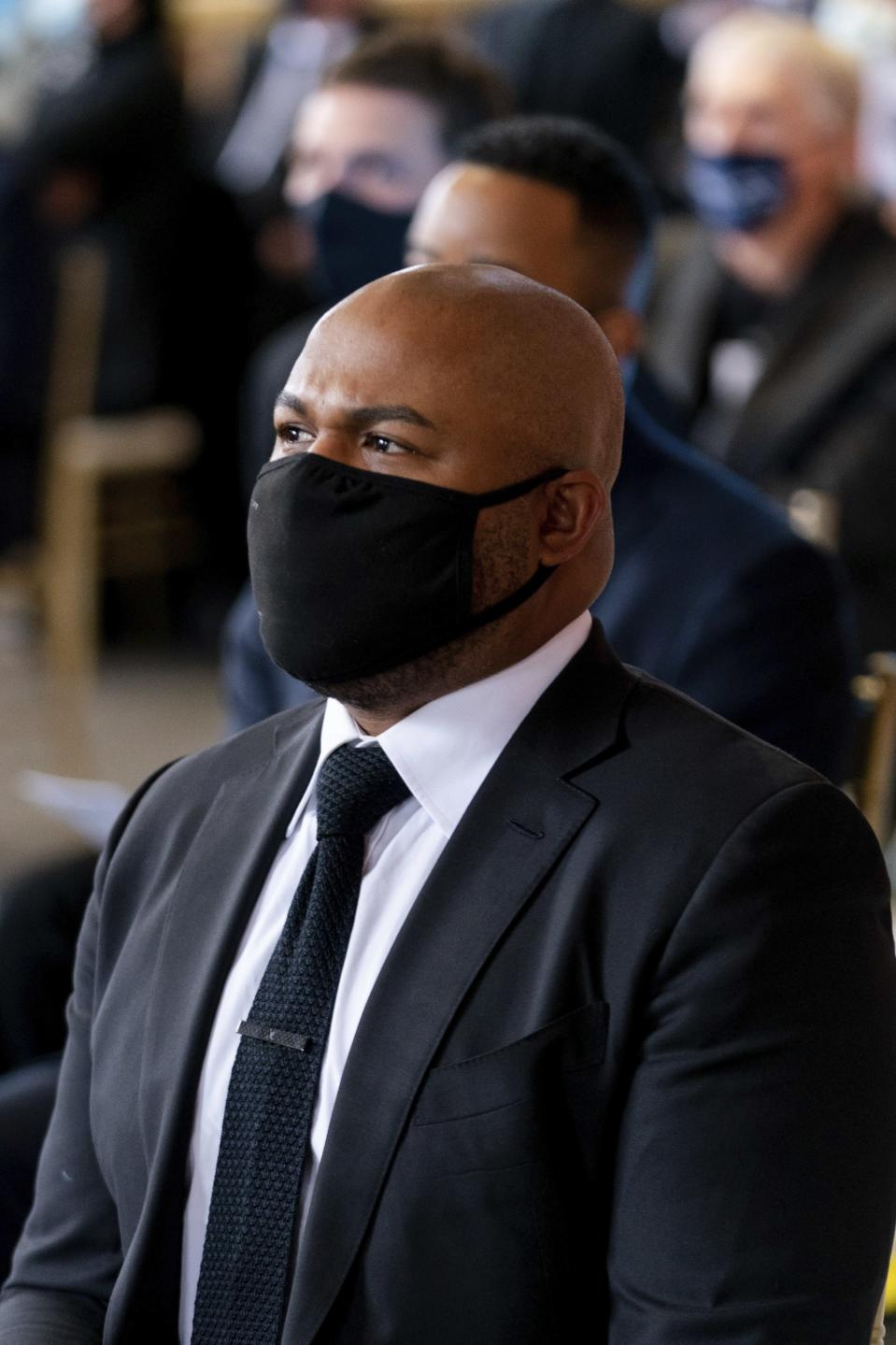 "Former Atlanta Braves player Andruw Jones listens during ""A Celebration of Henry Louis Aaron,"" a memorial service celebrating the life and enduring legacy of the late Hall of Famer and American icon, on Tuesday, Jan. 26, 2021, at Truist Park in Atlanta. (Kevin D. Liles/Atlanta Braves via AP, Pool)"
