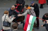 Pro- and anti-government supporters scuffle near a ceremony marking the 60th anniversary of 1956 anti-Communist uprising in Budapest, Hungary, October 23, 2016. REUTERS/Laszlo Balogh