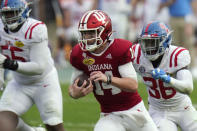 Indiana quarterback Jack Tuttle (14) runs past Mississippi linebacker Ashanti Cistrunk (36) during the second half of the Outback Bowl NCAA college football game Saturday, Jan. 2, 2021, in Tampa, Fla. (AP Photo/Chris O'Meara)