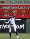 Seattle Mariners second baseman Kristopher Negron shields his eyes from the sun with his glove as he eyes a pop up from Los Angeles Angels' Jonathan Lucroy in the second inning of a spring training baseball game Sunday, March 10, 2019, in Tempe, Ariz. Negron made the catch. (AP Photo/Elaine Thompson)