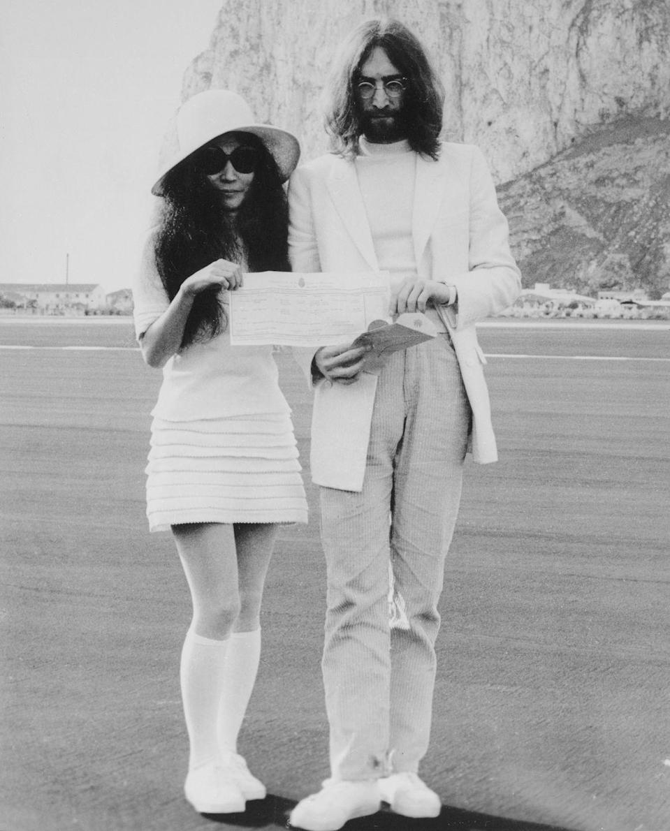 <p>The Beatle and his songwriter bride pose with their marriage certificate on March 21, 1969. The pair are standing in front of the Rock of Gibraltar in southwestern Europe. Their marriage was the second for the famous rocker and the third for her. They remained married until his tragic death in 1980.</p>