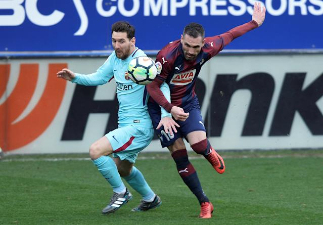 Soccer Football - La Liga Santander - Eibar vs FC Barcelona - Ipurua, Eibar, Spain - February 17, 2018 Barcelona's Lionel Messi in action with Eibar's Anaitz Arbilla REUTERS/Vincent West
