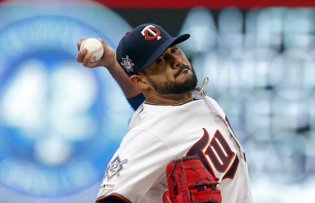 Minnesota Twins' pitcher Martin Perez throws against the Toronto Blue Jays in the first inning of a baseball game Monday, April 15, 2019, in Minneapolis. (AP Photo/Jim Mone)