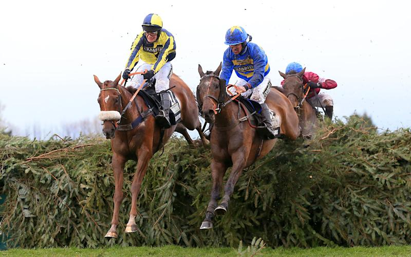 The Last Samuri ridden by David Bass, Vics Canvas ridden by Robert Dunne and Rule the World ridden by David Mullins during the 2016 Grand National - PA Wire