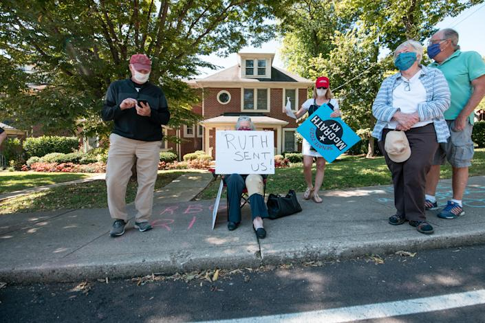 A group of protesters rally in front of Senate Majority Leader Sen. Mitch McConnell's home on September 19, 2020 in Louisville, Kentucky. / Credit: JON CHERRY/Getty Images