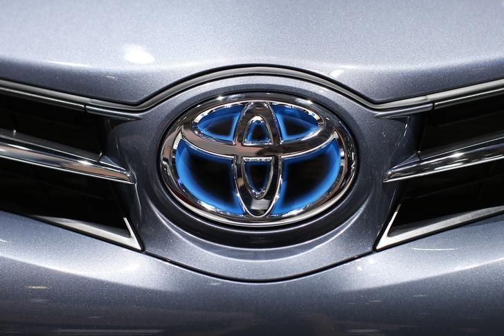 A Toyota logo is seen on a car displayed on media day at the Paris Mondial de l'Automobile