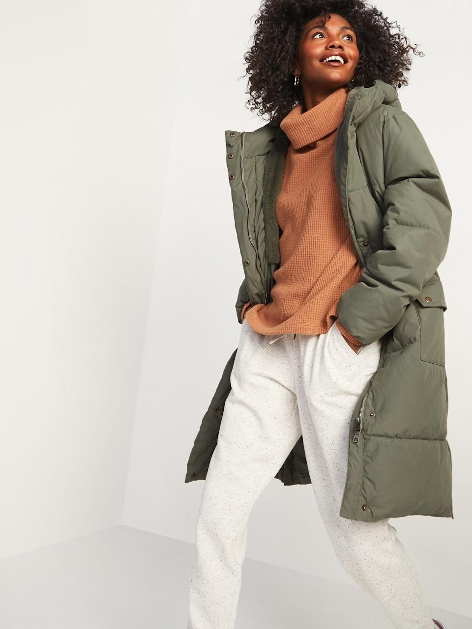 <p>When the wind picks up you'll love zipping up this <span>Faux-Fur Lined Hooded Long Puffer Coat</span> ($100).</p>