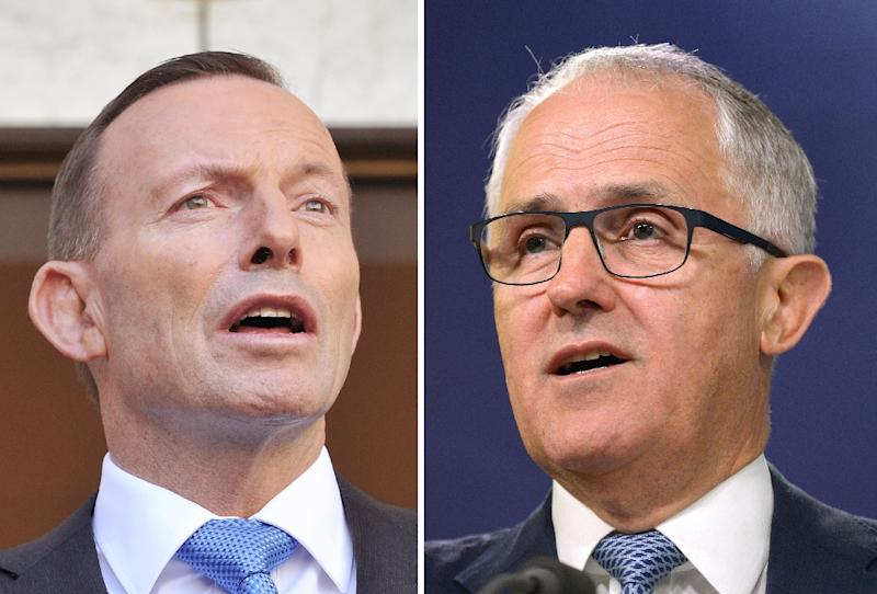 Australian Prime Minister Tony Abbott (left) has been ousted in a party vote forced by Malcolm Turnbull (AFP Photo/Greg Wood)