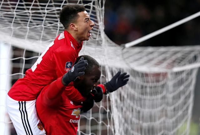 Soccer Football - FA Cup Quarter Final - Manchester United vs Brighton & Hove Albion - Old Trafford, Manchester, Britain - March 17, 2018 Manchester United's Romelu Lukaku celebrates scoring their first goal with Jesse Lingard REUTERS/Andrew Yates