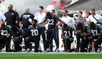 Jacksonville Jaguars players kneel in protest during the national anthem before the NFL International Series match at Wembley Stadium, London on Sept. 24, 2017. (Photo by Simon Cooper/PA Images via Getty Images)