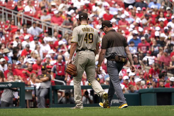 San Diego Padres starting pitcher Jake Arrieta (49) leaves a baseball game against the St. Louis Cardinals during the first inning Sunday, Sept. 19, 2021, in St. Louis. (AP Photo/Jeff Roberson)