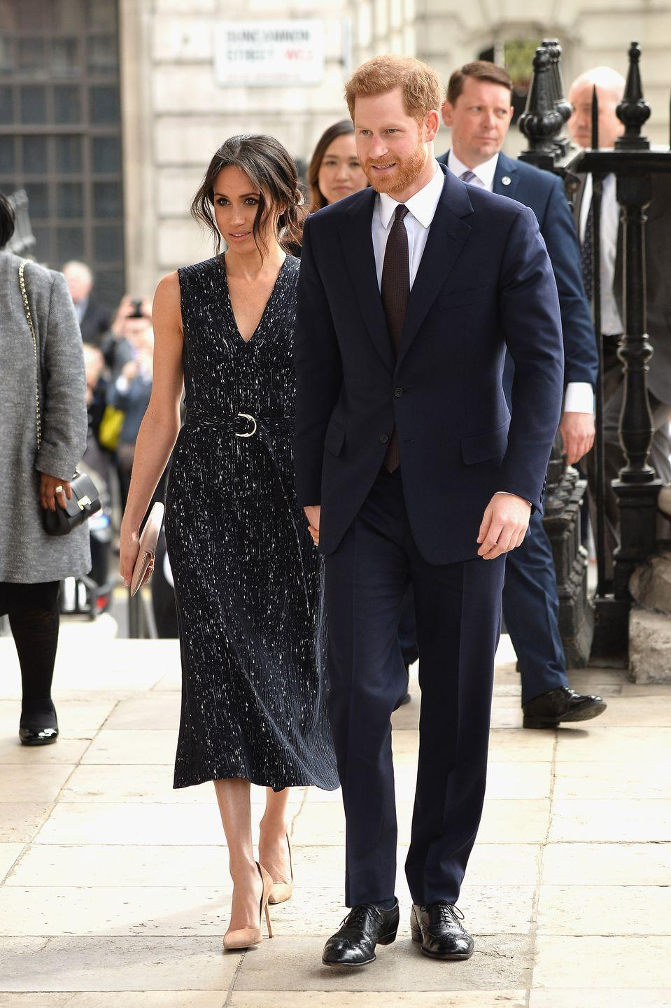 """<p>Meghan chose a black dress by Hugo Boss for a somber event in London: <a href=""""https://www.townandcountrymag.com/society/tradition/a19889435/meghan-markle-black-dress-stephen-lawrence-memorial/"""" rel=""""nofollow noopener"""" target=""""_blank"""" data-ylk=""""slk:a memorial service to mark the 25th anniversary"""" class=""""link rapid-noclick-resp"""">a memorial service to mark the 25th anniversary</a> of Stephen Lawrence's murder. The soon-to-be royal completed the look with a pair of Manolo Blahnik pumps. </p><p><a class=""""link rapid-noclick-resp"""" href=""""https://go.redirectingat.com?id=74968X1596630&url=https%3A%2F%2Fwww.saksfifthavenue.com%2Fmain%2FProductDetail.jsp%3FPRODUCT%253C%253Eprd_id%3D845524446412984&sref=https%3A%2F%2Fwww.townandcountrymag.com%2Fstyle%2Ffashion-trends%2Fg3272%2Fmeghan-markle-preppy-style%2F"""" rel=""""nofollow noopener"""" target=""""_blank"""" data-ylk=""""slk:SHOP NOW"""">SHOP NOW</a> <em>Manolo Blahnik BB 105 Suede Point Toe Pumps, $595</em><br></p>"""
