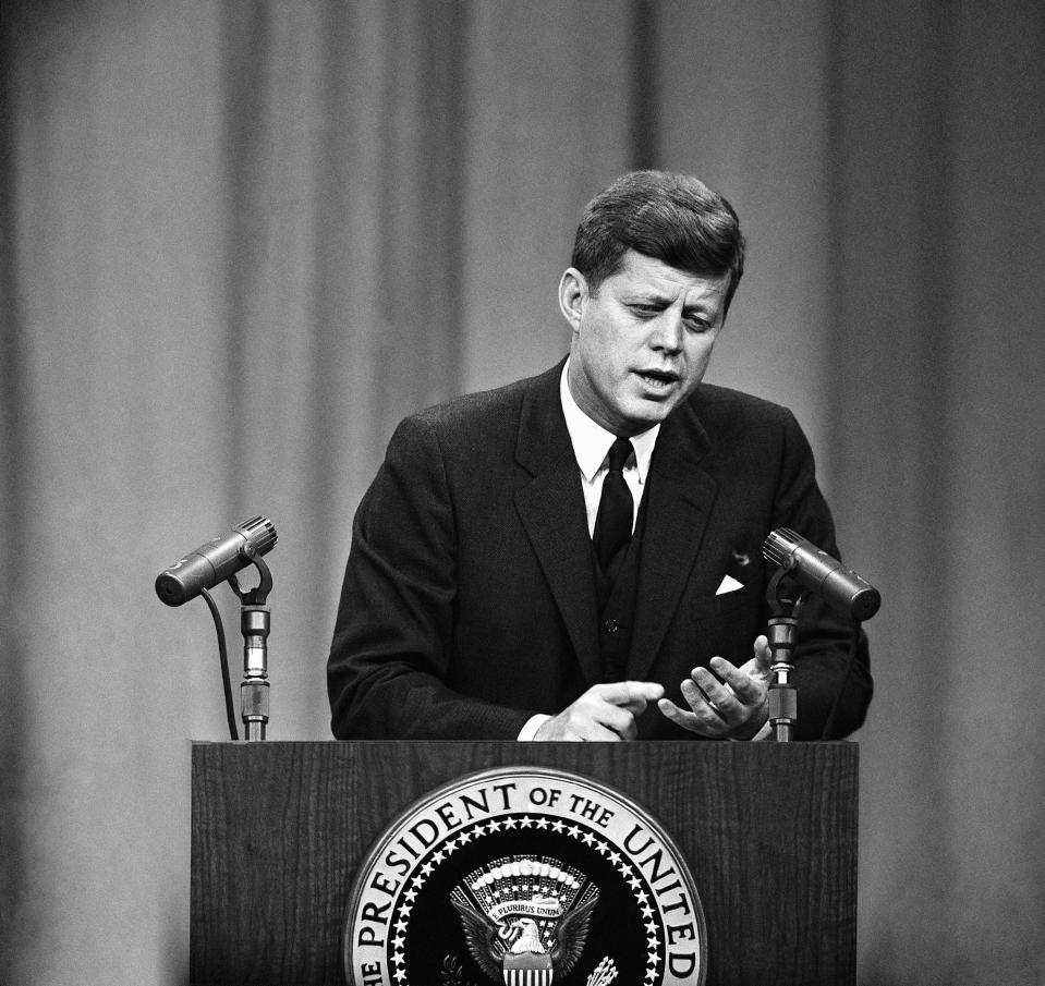 """FILE - In this March 8, 1961 file photo, President John F. Kennedy speaks during a news conference in Washington. On Friday, June 25, 2021, the Associated Press reported on stories circulating online incorrectly claiming Kennedy said, """"There are people in Washington D.C. in positions of power to whom the border is just a nuisance. And I think some of them believe that illegal immigration is a moral good. It is not."""" (AP Photo, File)"""