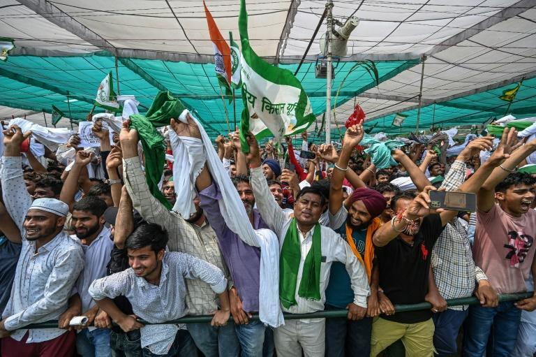 Farmers and supporters representing various unions shout slogans as they attend the rally (AFP/Money SHARMA)