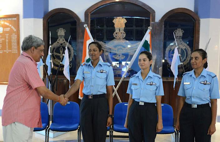 Indian Minister of Defence Manohar Parrikar (L) congratulates three of the Indian Air Force's fighter pilots Bhawana Kanth (L), Avani Chaturvedi (C) and Mohana Singh after the combined graduation parade at the air force academy at Dundigal in Hyderabad on June 18, 2016. The first three women fighter pilots of the Indian Air Force have been conferred with the President's commission, and 22 women trainees were commissioned as flying officers from the Air Force Academy. / AFP / NOAH SEELAM        (Photo credit should read NOAH SEELAM/AFP/Getty Images)