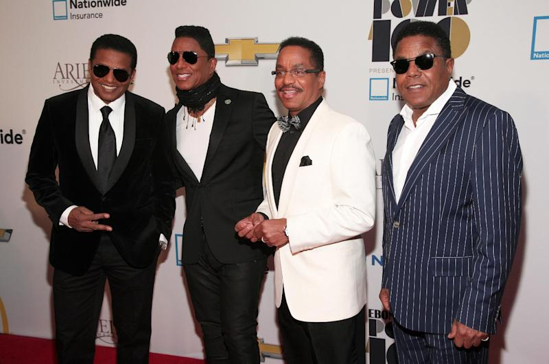 From left, musicians Jackie Jackson, Jermaine Jackson, Marlon Jackson and Tito Jackson attend the Ebony Power 100 Gala, on Monday, Nov. 4, 2013, in New York. (Photo by Andy Kropa/Invision/AP)