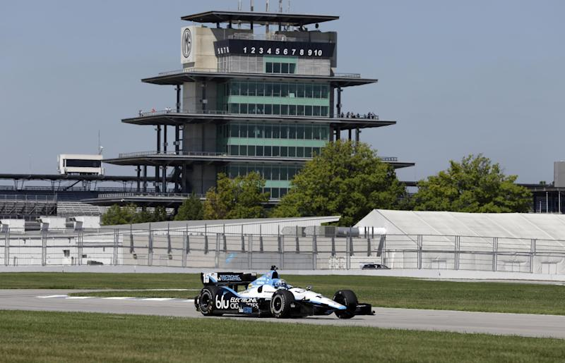 IndyCar driver Graham Rahal drives through a turn during a road course test at the Indianapolis Motor Speedway in Indianapolis, Wednesday, Sept. 4, 2013. (AP Photo/Michael Conroy)