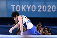 Down and out: Japan's Kohei Uchimura suffered a disappointing finale to his Olympic career after tumbling in the horizontal bars