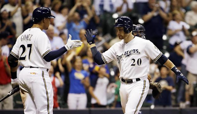 Milwaukee Brewers' Jonathan Lucroy (20) is congratulate by teammate Carlos Gomez after hitting a home run during the eighth inning of a baseball game against the Minnesota Twins Monday, June 2, 2014, in Milwaukee. (AP Photo/Morry Gash)