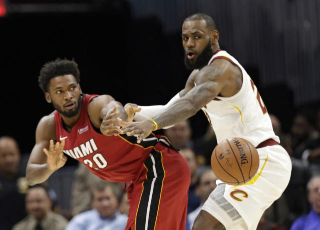 "<a class=""link rapid-noclick-resp"" href=""/nba/players/3704/"" data-ylk=""slk:LeBron James"">LeBron James</a> plays tight defense against <a class=""link rapid-noclick-resp"" href=""/nba/players/5470/"" data-ylk=""slk:Justise Winslow"">Justise Winslow</a> on Tuesday. (AP)"