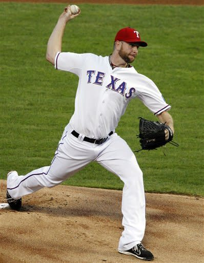 Texas Rangers starting pitcher Scott Feldman (39) delivers to the Oakland Athletics in the first inning of a baseball game, Tuesday, Sept. 25, 2012, in Arlington, Texas. (AP Photo/Tony Gutierrez)