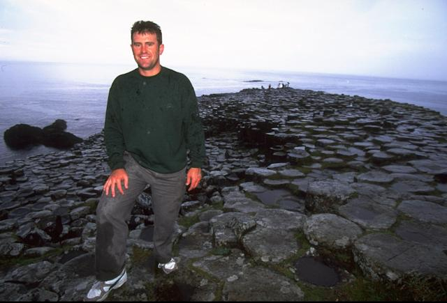 1 Aug 1997: Australian cricket captain Mark Taylor relaxes at the Giants Causeway in Northern Ireland during their Ashes tour. \ Mandatory Credit: Clive Mason /Allsport